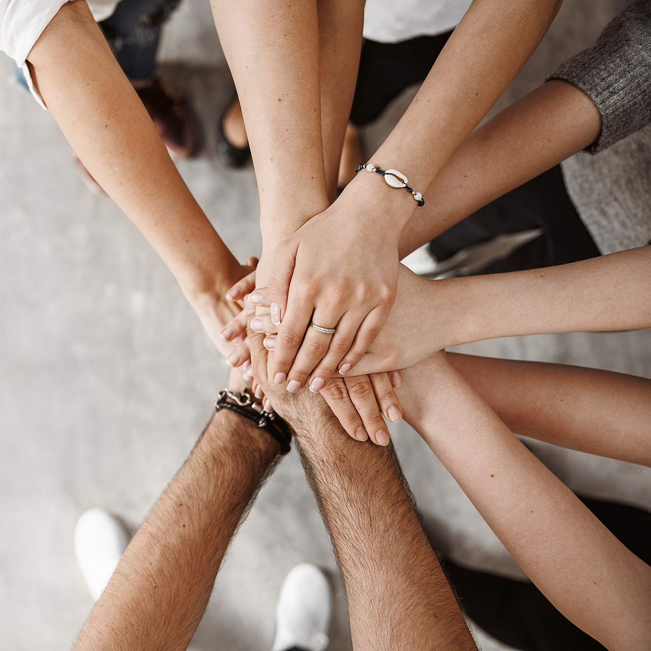 Hands in a circle ready for teamwork