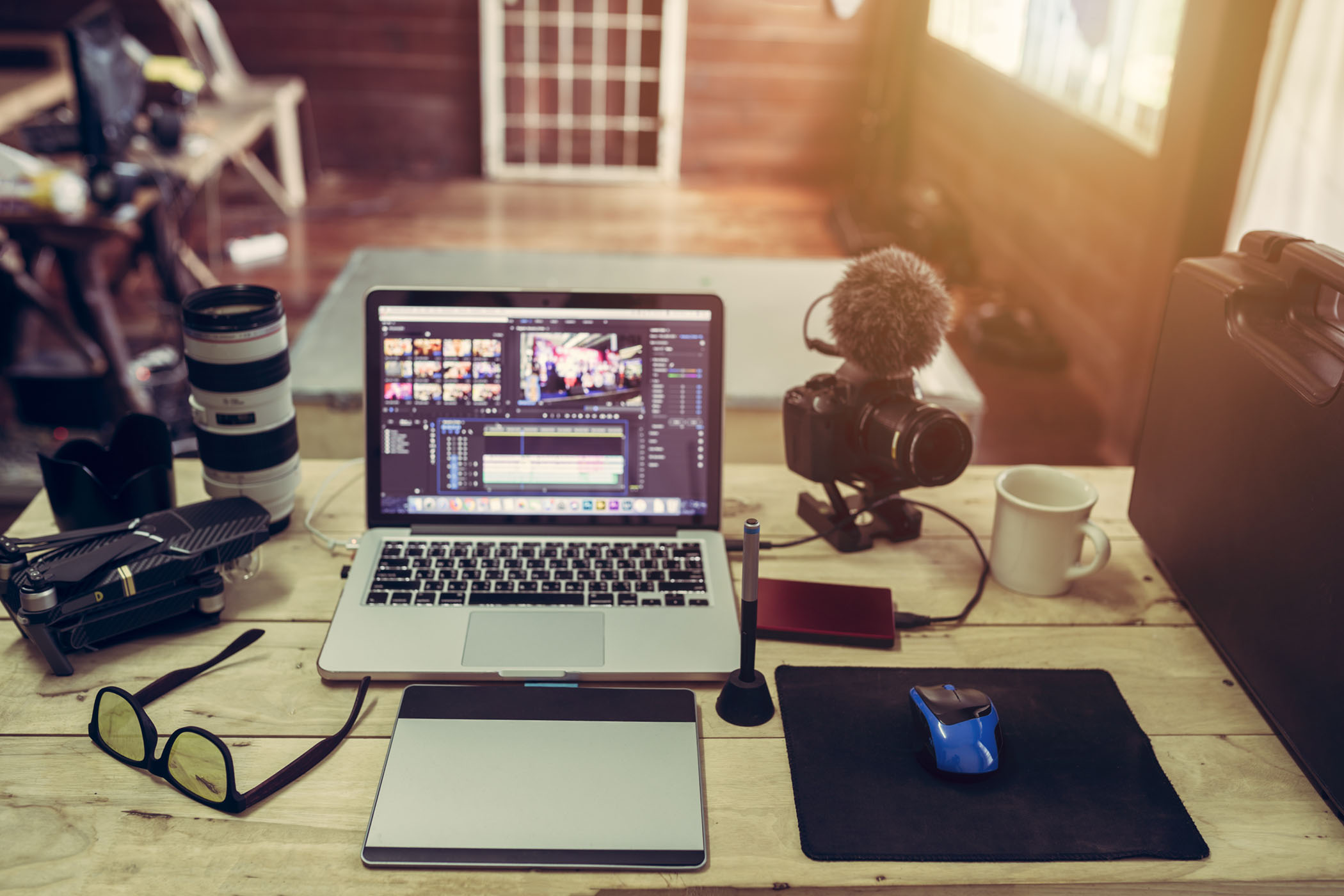 The laptop Camera and drone gear for editor man or freelance Vlo