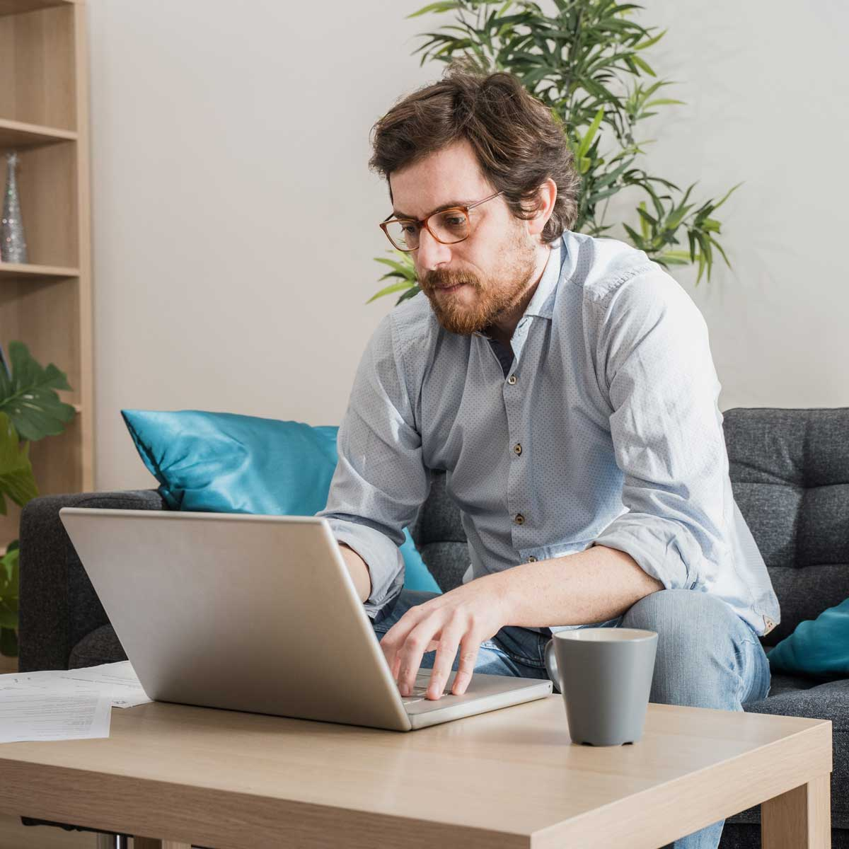 Male businessman working on laptop from home