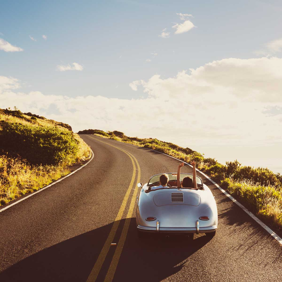 Coupe Driving on Country Road in Vintage Sports Car