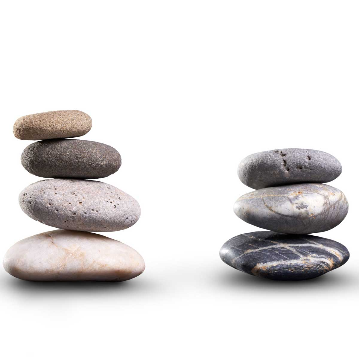 A collection of pile of stones isolated on a white background